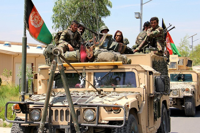 Afghan National Army troops move out from the 201 Corps headquarters at Tactical Base Gamberi in preparation for Operation Iron Triangle