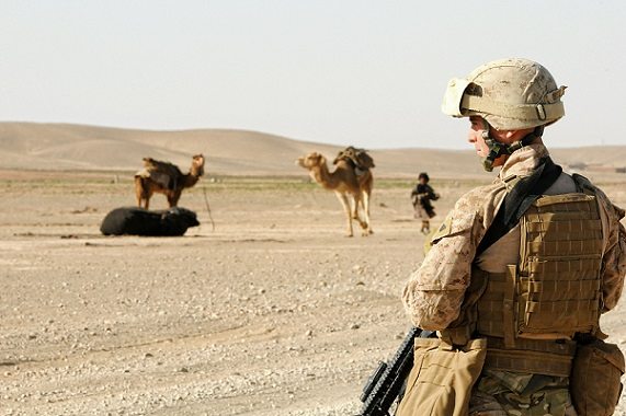 Cpl. Theodore Criswell, with 2nd Battalion, 11th Marines, stands guard at a checkpoint in Helmand province, Afghanistan, on March 10, 2012.
